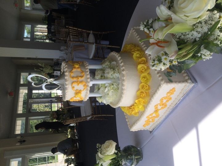 2-tiered, buttercream with rolled fondant swags & roses