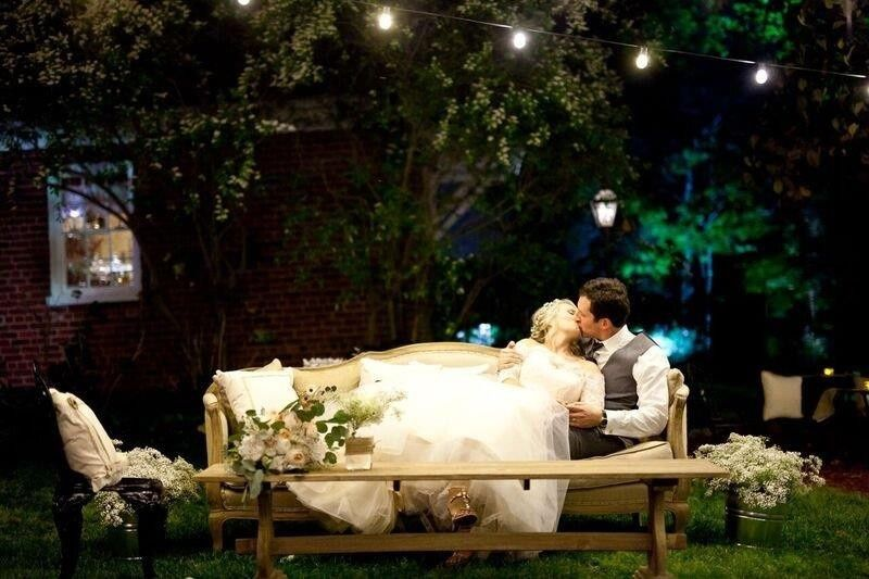 Newlyweds kissing on the lounge chair