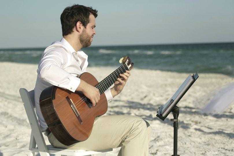 philip with guitar beach shot edit 51 1941513 158170514914194