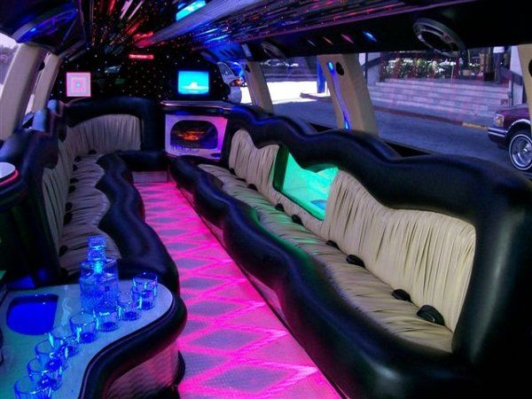 The inside of our Brand New 24 Passenger Cadillac Escalade is unbelievable with its million light...
