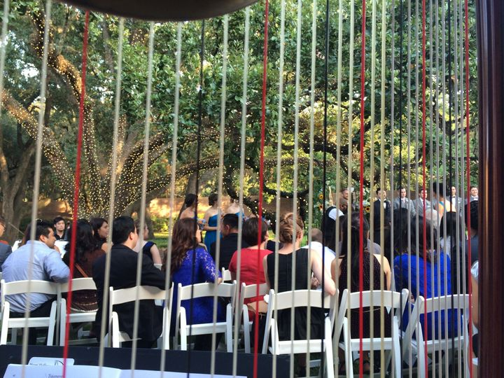 Under the canopy of a live oak for a wedding at Rice University