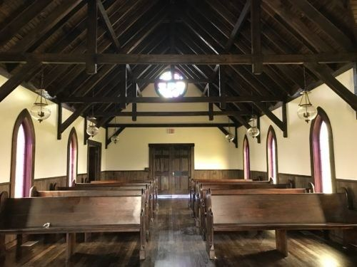 Interior of the 1800s Historic Replica Church looking backwards toward the guests