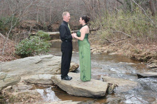 Couple holding hands on a spring