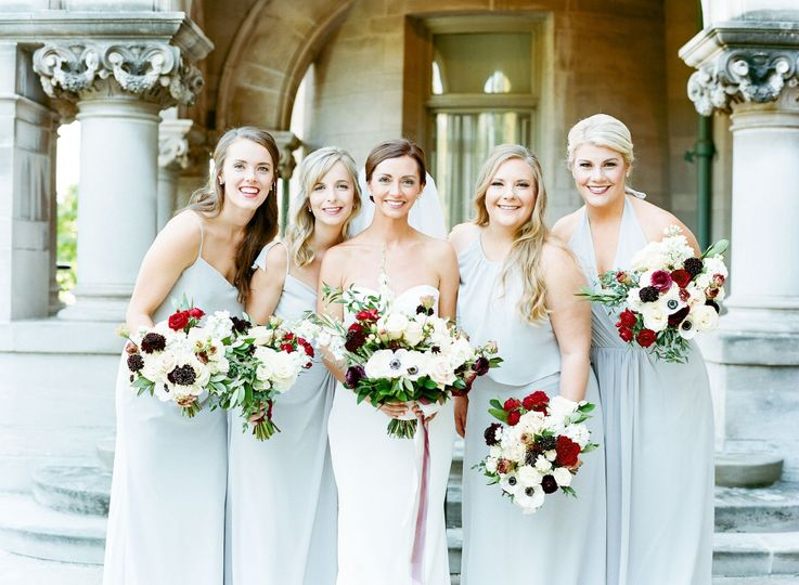 Excited bridal team with blooms