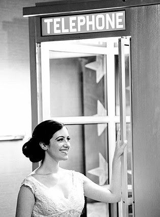 Bride in a a telephone booth