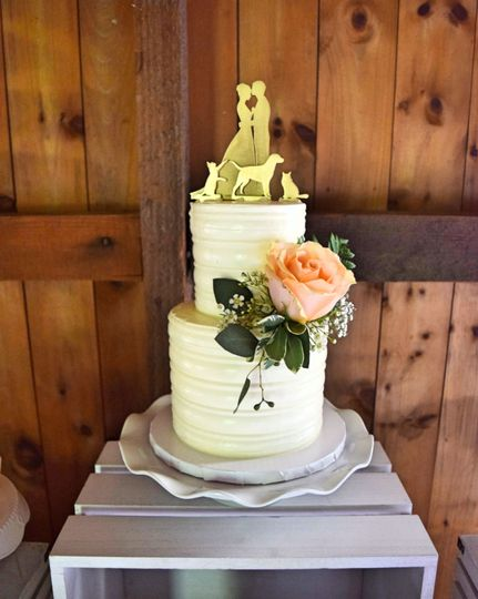 Two tier wedding cake with peach flowers
