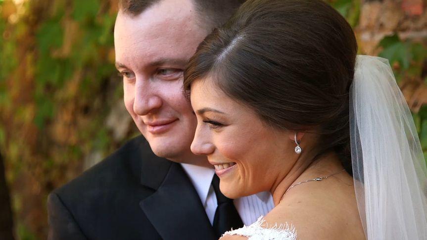 Bride and groom looking left