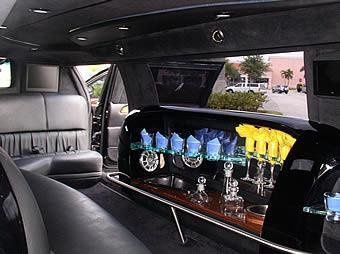 Our Krystal 10 passenger black stretch limousine also features a 5th door for easy entrance and...
