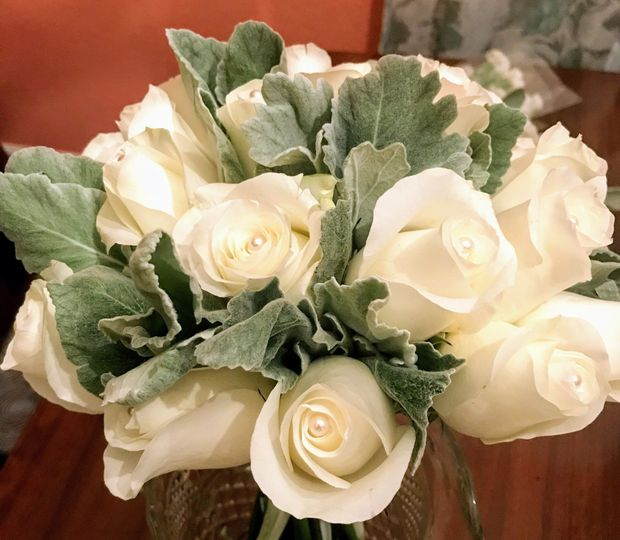 White roses and dusty miller