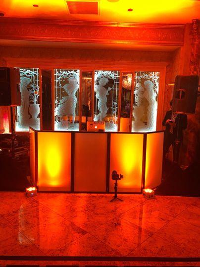 DJ booth with uplighting