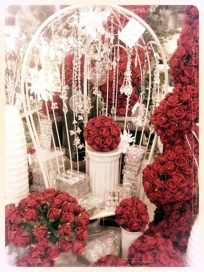 We Rent these gorgeous red rose kissing balls and large red rose topiaries! We also have ivory...