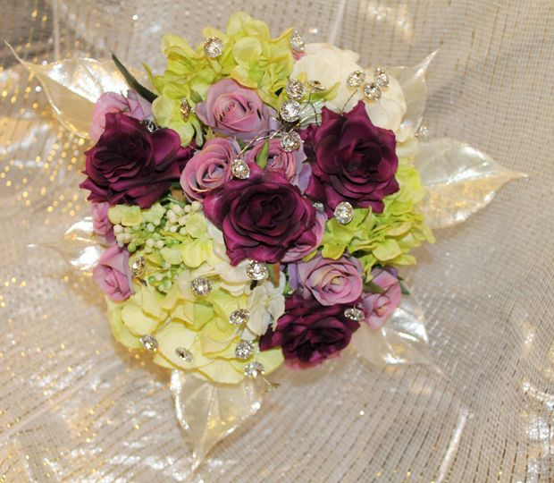 An example of one of our custom silk bouquets in plum, lavender, and shimmering ivory.