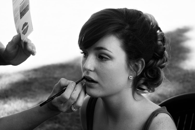 A bride getting her makeup done.