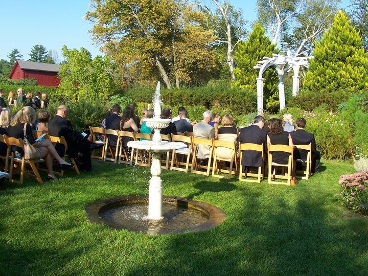 Garden wedding ceremony with fountain