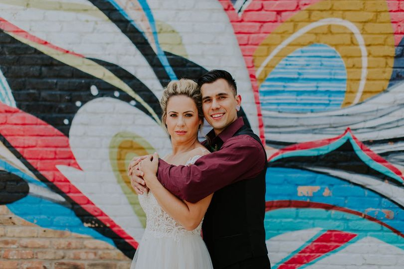 Couple infront of mural