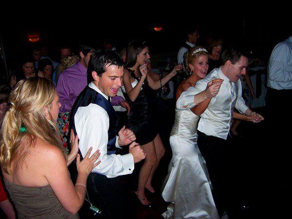 Bride and wedding guests dancing