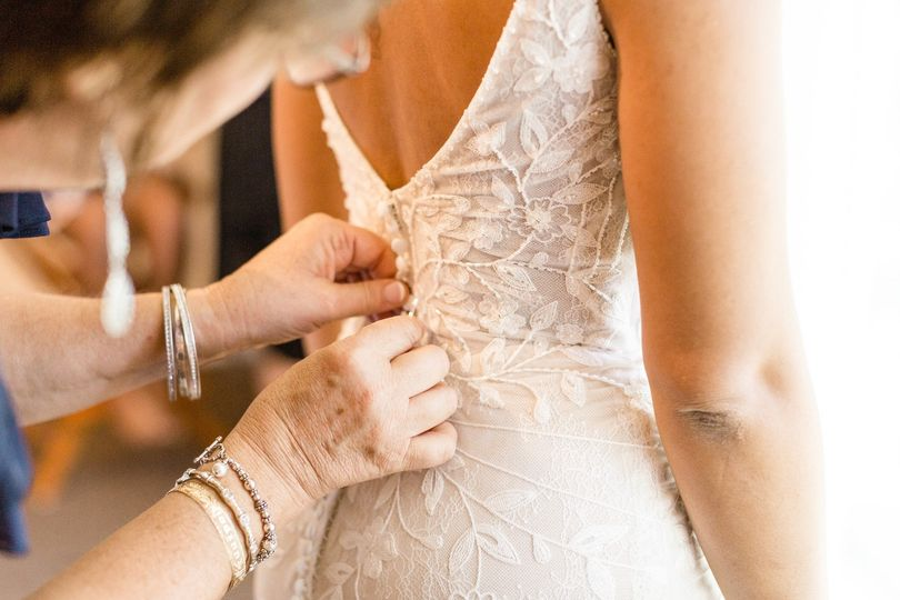 Buttoning up the wedding gown