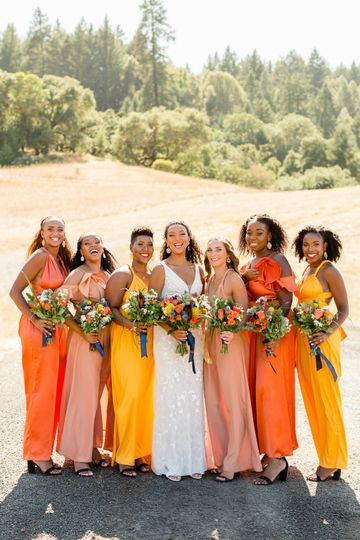 Vibrant bridesmaids with bouquets