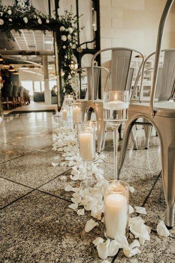 Wedding aisle candle and flowers decor