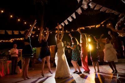 Bride and bridesmaids dance