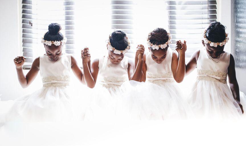 Flower girls in prayer