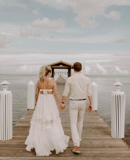 Newlyweds walking down the dock