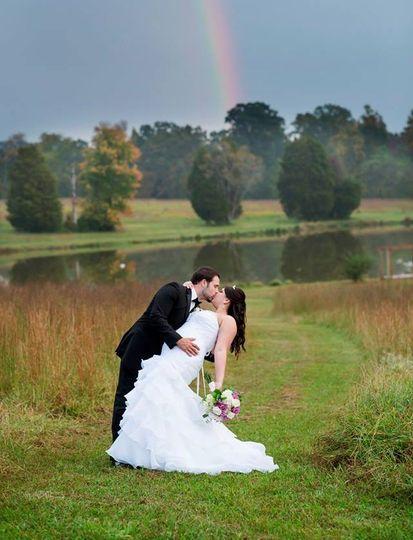 Couple posing under a rainbow