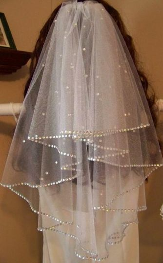 This is a full circle cut, elbow length, white shimmer tulle veil that is double faced trimmed with...