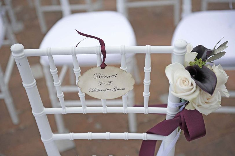 ceremony chair setting and flower arrangement