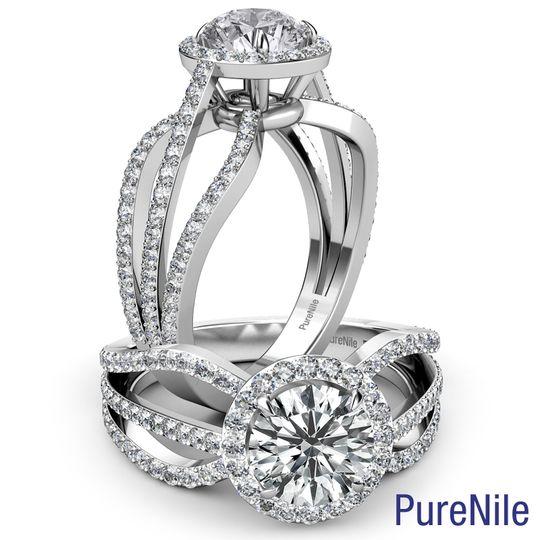 This stunning triple split shank designer halo diamond engagement ring made from 14k white gold....