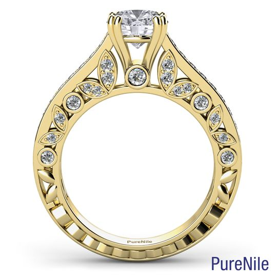 A stunning floral motif diamond engagement ring made from 14k yellow gold. Item #R600