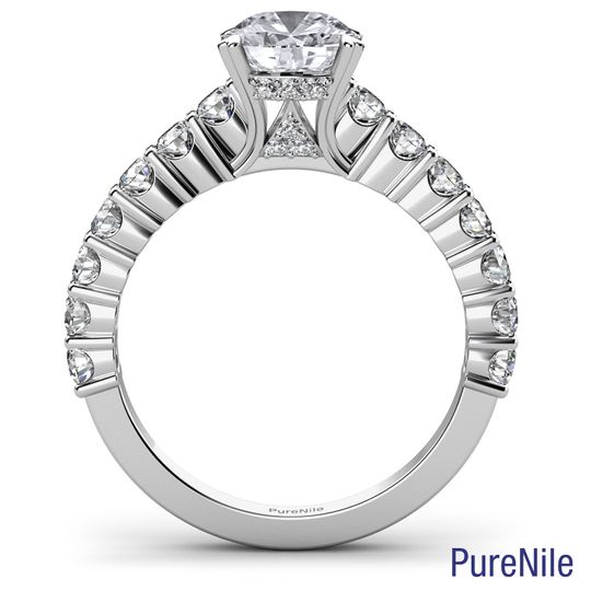 This gorgeous sidestone diamond engagement ring made from 14k white gold. Features a round cut...