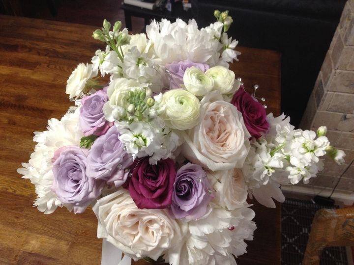 Purple, white and burgundy roses
