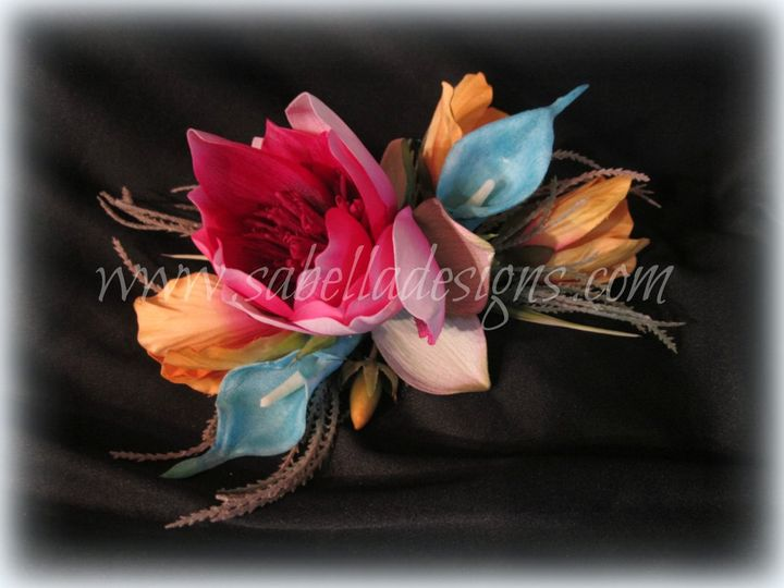 An amazing corsage full of tropical flowers with vibrant colors.