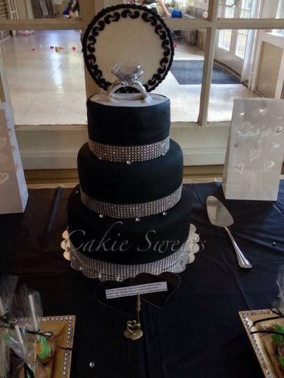 Unique wedding ring cake. Ring and other accessories are not edible.