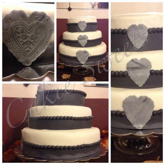 Simple yet elegant wedding celebration cake.