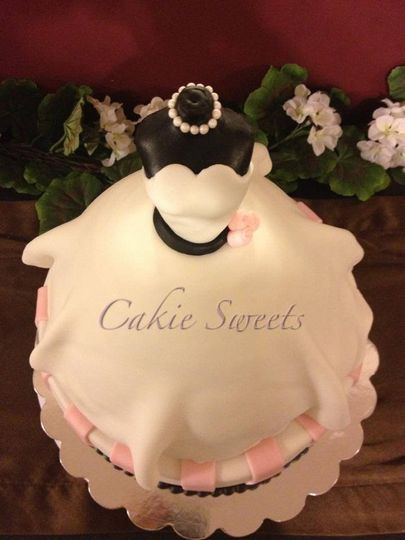 Wedding gown cake perfect for a bridal shower or as a wedding cake with cascading cupcakes. Color...