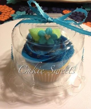 Individual cupcale that can be given as a favor or an alternative to a traditional wedding cake....