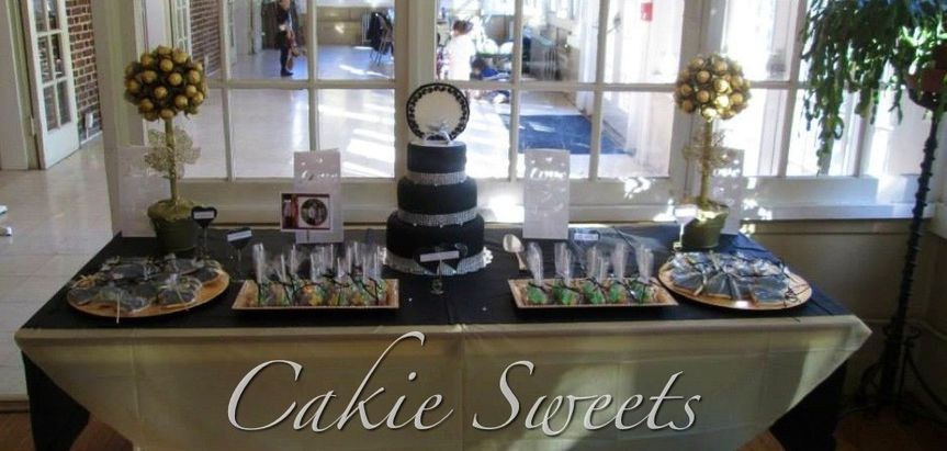 Elegant Sweets table with wedding ring cake. Includes Rocher topiaries, cake pops, and personalized...