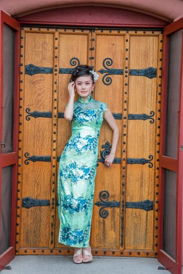 A Chinese bride wearing traditional Cheongsam  wedding dress. ©2018 Fort Point Media LLC, All Rights...
