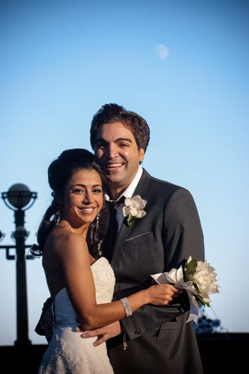 Portrait of Greek groom and Persian bride with moon backdrop at Boston Harbor Hotel wedding. ©2018...