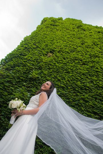 Bride with flowing veil beside ivy wall on Granby St. at Boston University. ©2018 Fort Point Media...
