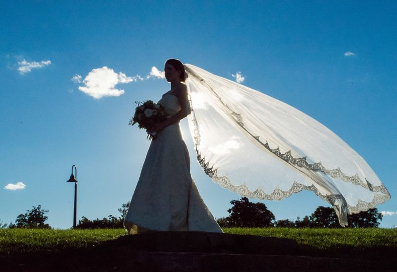 Bridal portrait with embroidered cathedral veil outside Barn at Gibbet Hill. ©2018 Fort Point Media...