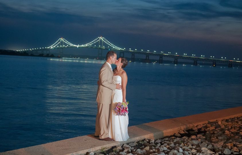 Wedding kiss with the Pell Newport Bridge as a backdrop. ©2018 Fort Point Media LLC, All Rights...
