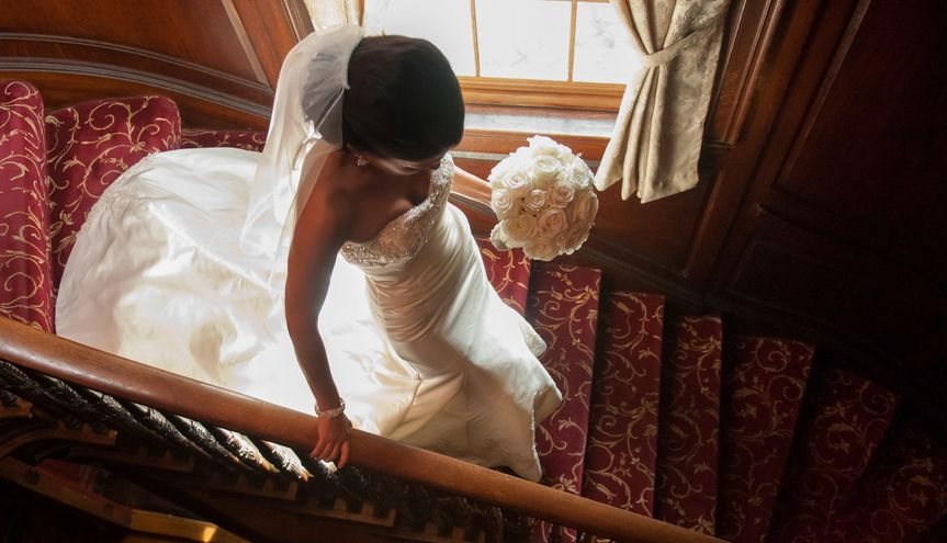 Bride ready for wedding, descending stairwell at Lanam Club. ©2018 Fort Point Media LLC, All Rights...