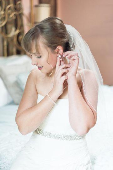 Bride fitting earrings