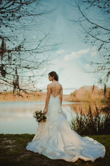 Bride beside lake