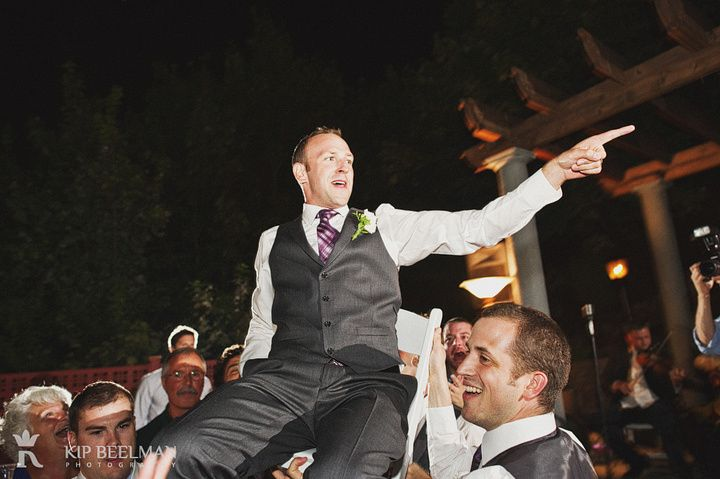 A groom on a chair in the air