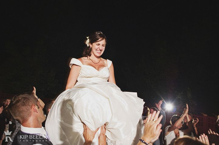 A bride on a chair in the air