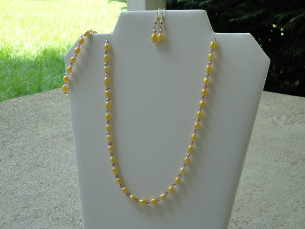 Stunning golden yellow freshwater rice pearls have been paired up with Amethyst Swarovski Crystals...